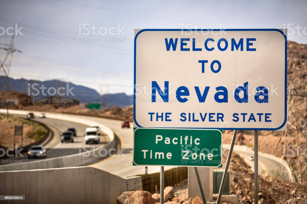 Entrance greeting sign on the highway border between Nevada and...