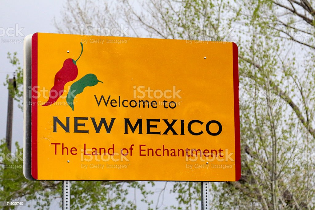 Welcome to New Mexico sign against overcast sky and trees stock photo