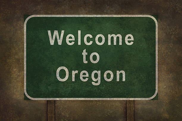 Welcome to Oregon roadside sign illustration Welcome to Oregon road sign illustration with distressed ominous background oregon us state stock pictures, royalty-free photos & images
