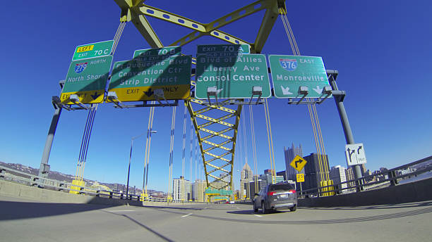 Welcome to Pittsburgh A view of Pittsburgh as you emerge from the Fort Pitt Tunnels.  pittsburgh bridge stock pictures, royalty-free photos & images