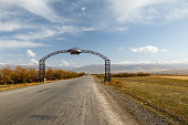 Suusamyr, Kyrgyzstan - October 06, 2019: Welcome to Suusamyr. Road sign at the entrance to the village. Jayyl District. Chuy Region. Kyrgyzstan.