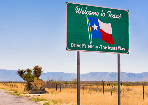 Welcome to Texas and Drive Friendly road sign stock photo
