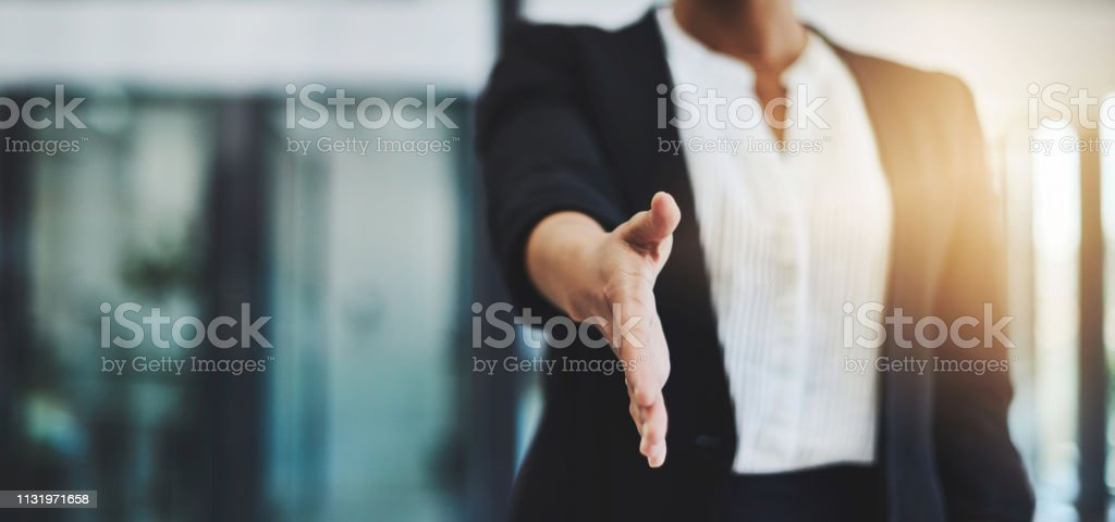 Welcome to the best company in the business Cropped shot of an unidentifiable businesswoman extending her arm for a handshake Adult Stock Photo