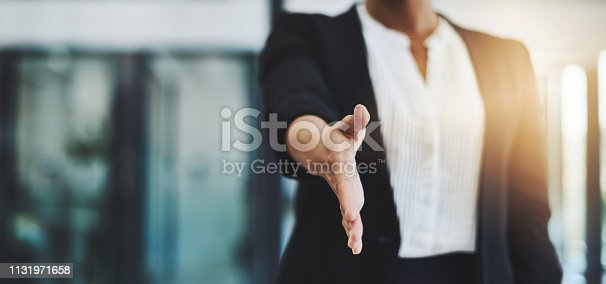 Cropped shot of an unidentifiable businesswoman extending her arm for a handshake