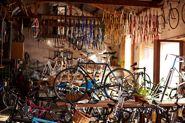 Welcome to the bicycle workshop Shot of a bicycles and equipment in a bicycle repair shophttp://195.154.178.81/DATA/i_collage/pu/shoots/805313.jpg bicycle shop stock pictures, royalty-free photos & images