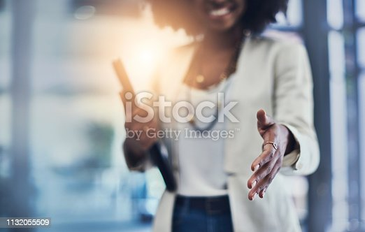 Shot of an unrecognizable businesswoman reaching out for a handshake