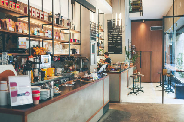 Welcome to the shop Shot of a countertop with an arrange of baked goods placed on top of it inside of a coffee shop during the day coffee shop stock pictures, royalty-free photos & images