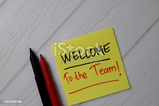 Welcome To The Team! text on sticky notes with office desk.