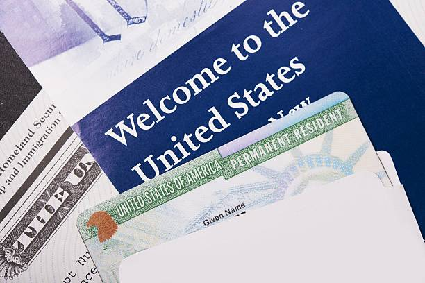 Welcome to the USA Welcome to the USA. Immigration Welcome Letter and Green Card Closeup. United States Homeland Security. department of homeland security stock pictures, royalty-free photos & images