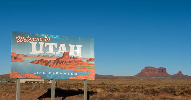 Welcome to Utah sign with butte in the background stock photo
