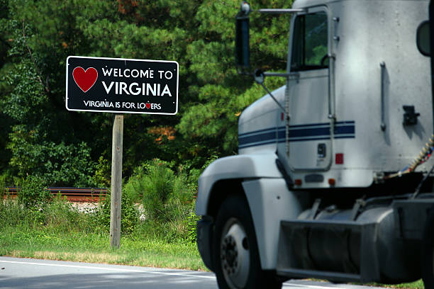 Welcome to Virginia sign Welcome to Virginia sign at the North Carolina state line along U.S route 301.  Big truck passing by and entering Virginia. north carolina us state stock pictures, royalty-free photos & images