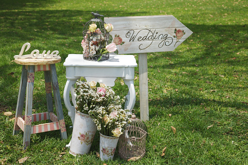 Wood hand made welcome wedding decoration on lawn