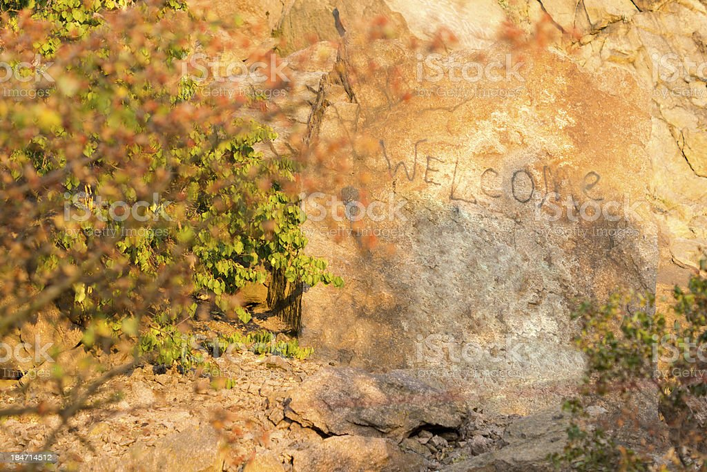 Welcome written on a mountain rock royalty-free stock photo