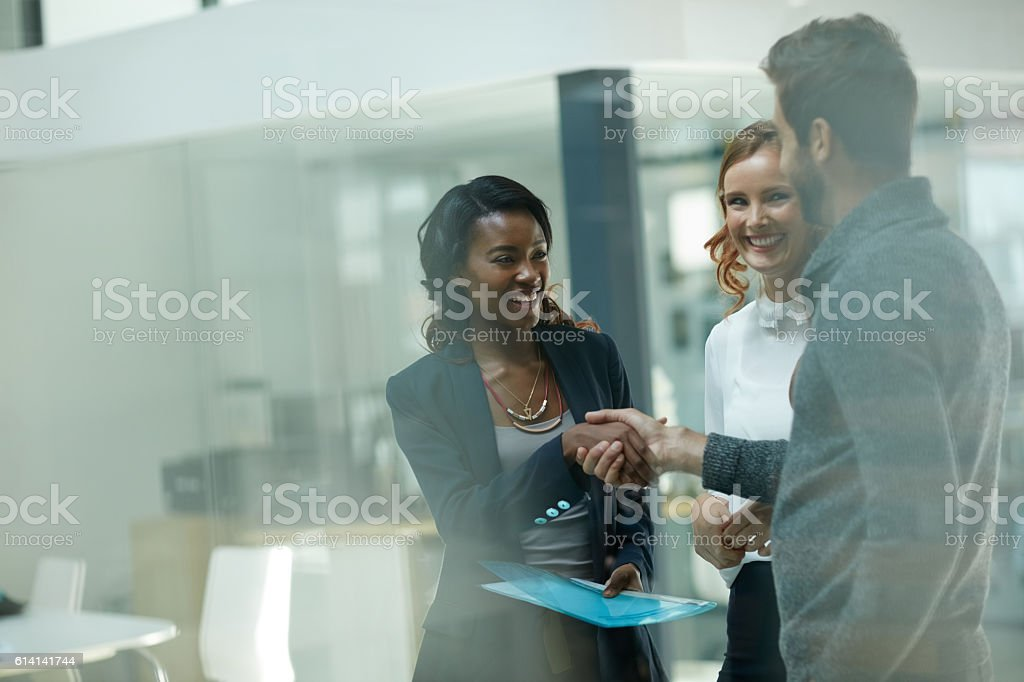 Welcoming a new member to the team stock photo