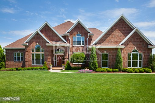 istock Welcoming Brick Home With Perfect Lawn 496974795