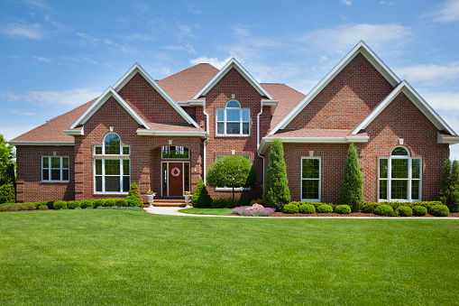 Welcoming Brick Home With Perfect Lawn Stock Photo - Download Image Now