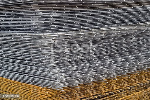 Welded iron mesh panels for reinforced concrete background at the construction site. Bar mat reinforcement mesh.