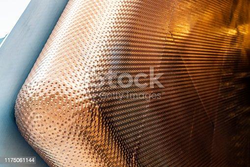 Well Welded Round Edge of Bronze Panels. Golden Color Textured Cladding Facade.