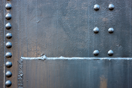 Welded Steel Background with Rivets