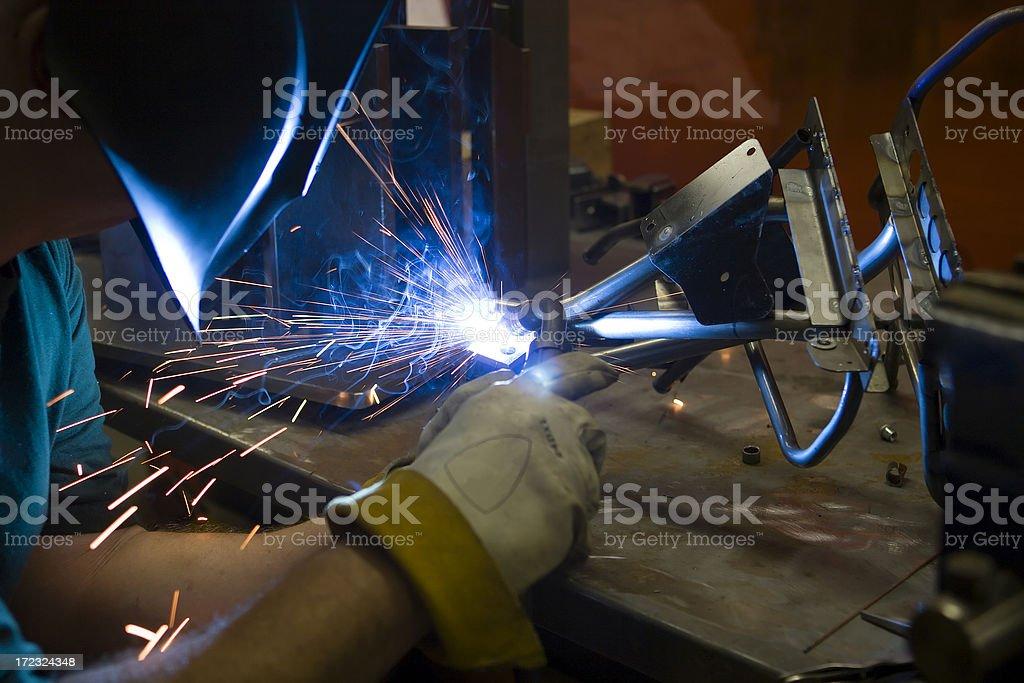 Welder welding a metal frame