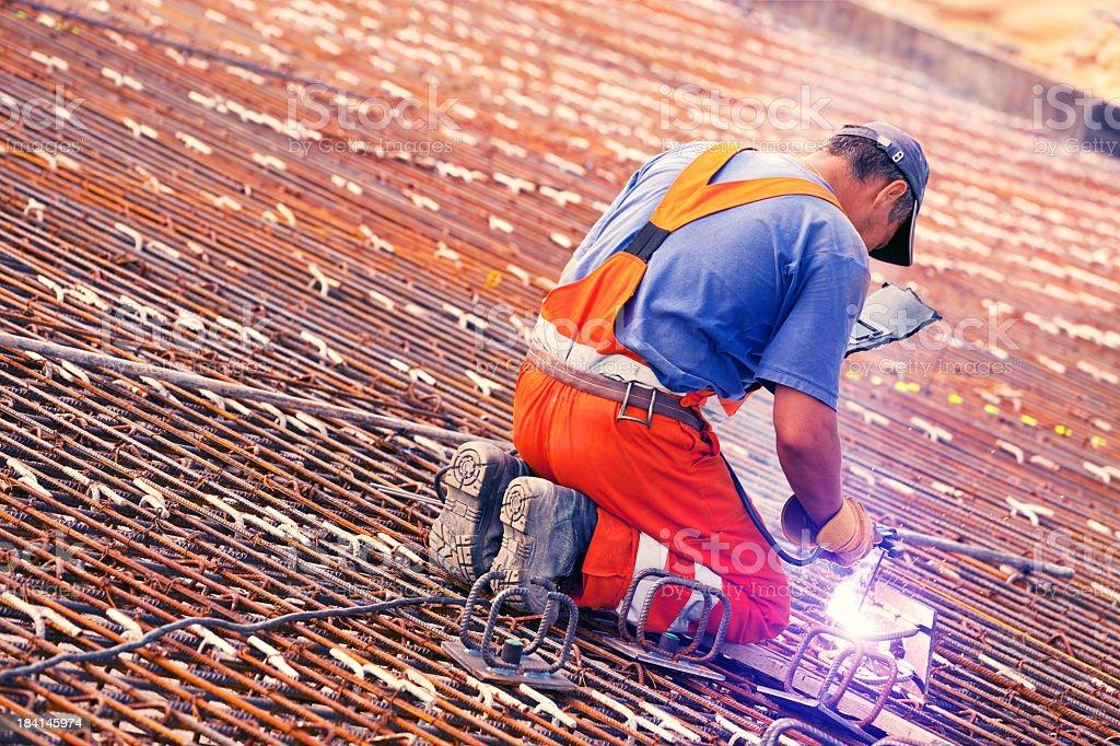 Welder and Concrete reinforcement stock photo