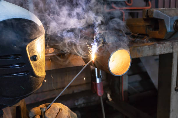 welder brews a control sample from small diameter pipes to confirm his qualification - diameter stock pictures, royalty-free photos & images