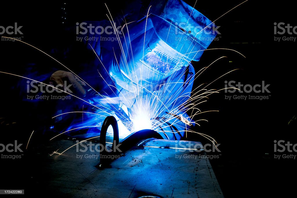 Welder in action stock photo