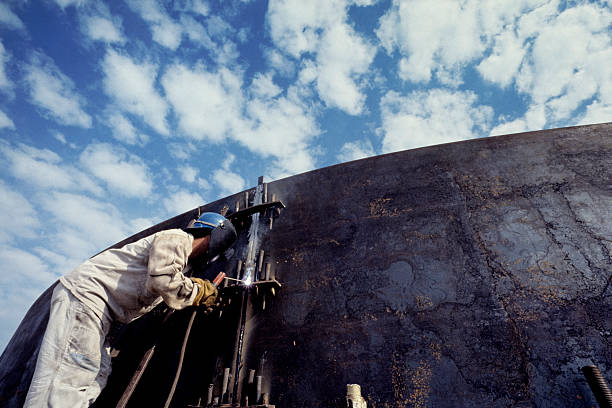 welder in tank stock photo