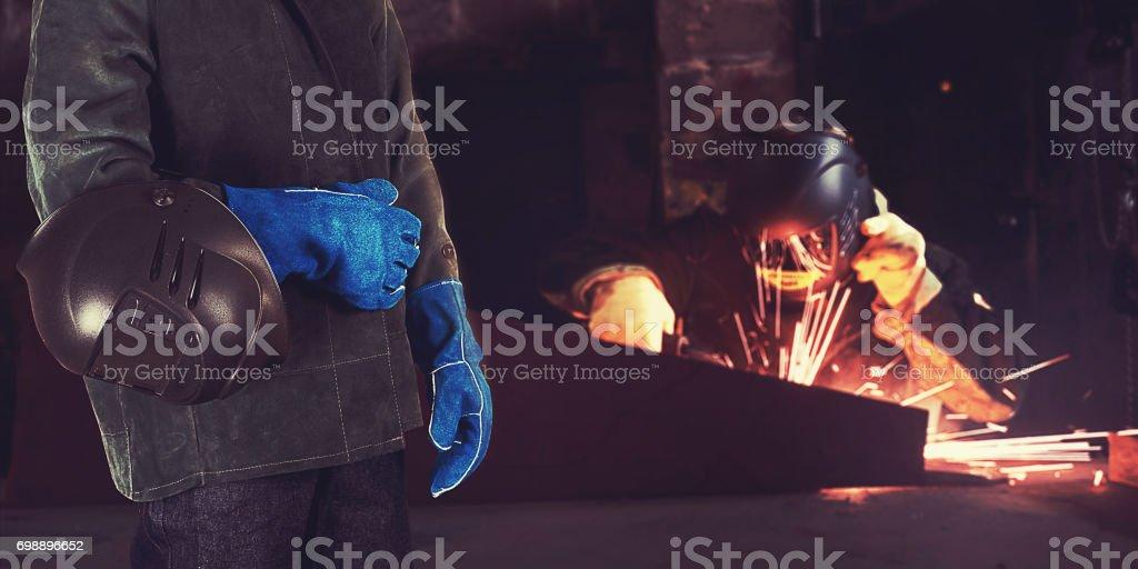 Welder in the factory stock photo