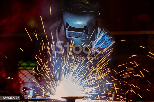 istock Welder is welding automotive part 686062776