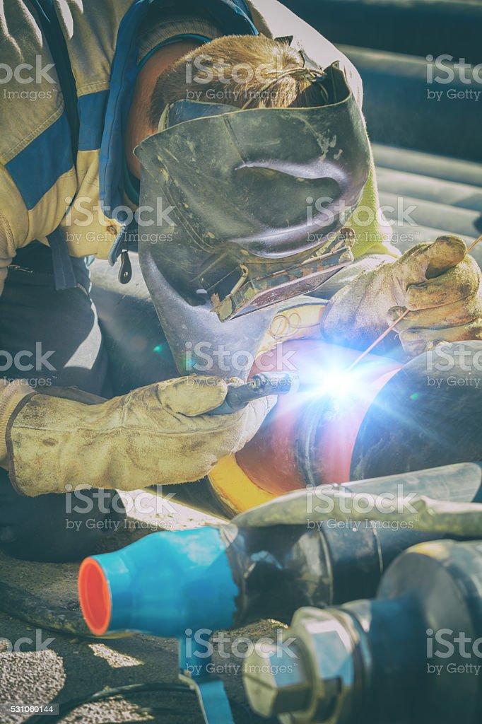 Welder on a construction site.