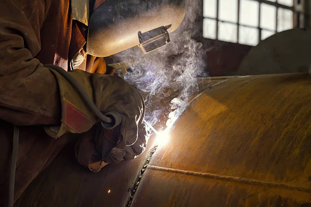 welder performs welding large diameter pipe - diameter stock pictures, royalty-free photos & images