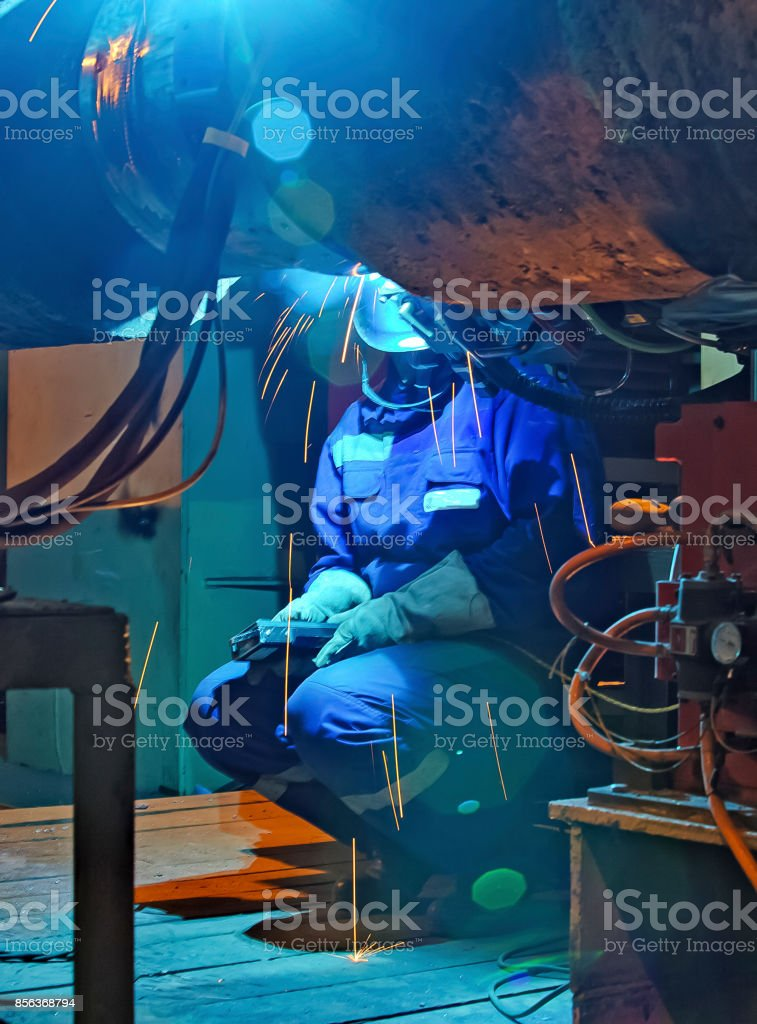 Welder resting during a break at work. stock photo
