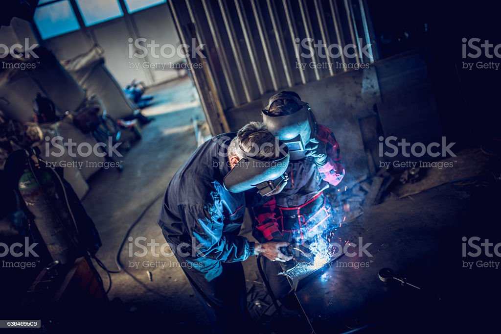 Welder team in workshop stock photo
