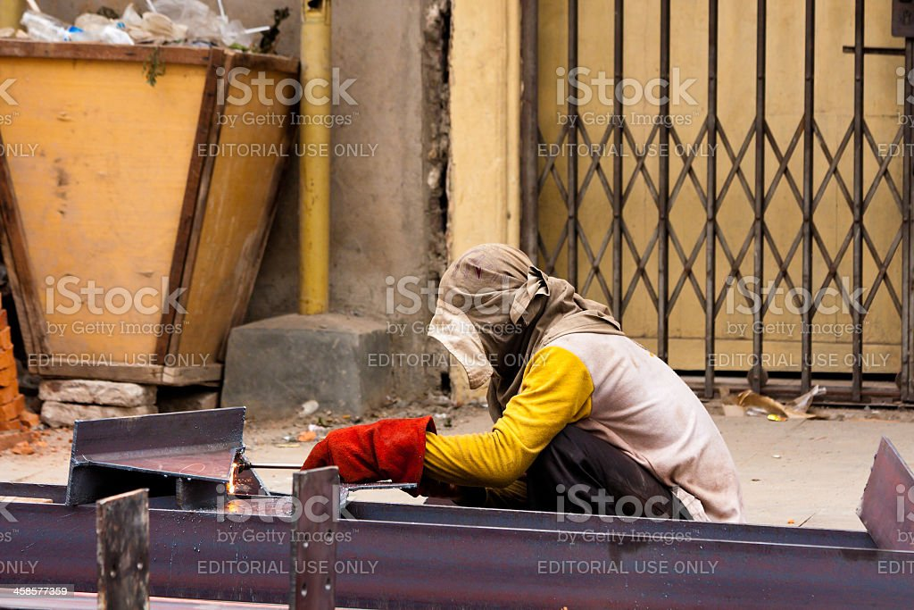 Welder using blowtorch on construction site royalty-free stock photo
