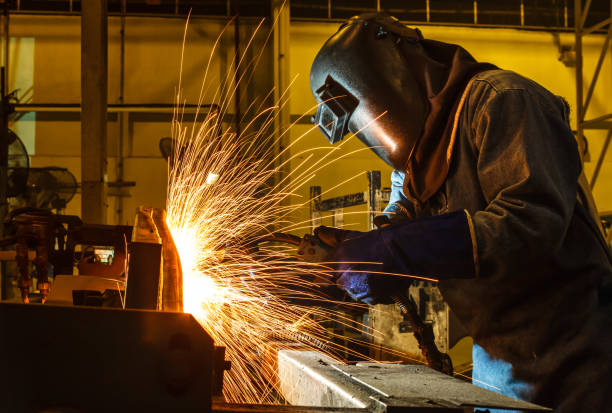 welder, welding automotive part in a car factory stock photo