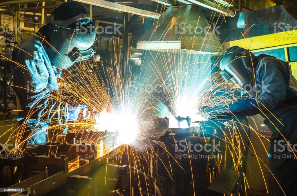 welder, welding automotive part in a car factory stock photo