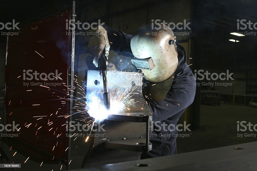 Welder Welding on Metal With Sparks stock photo