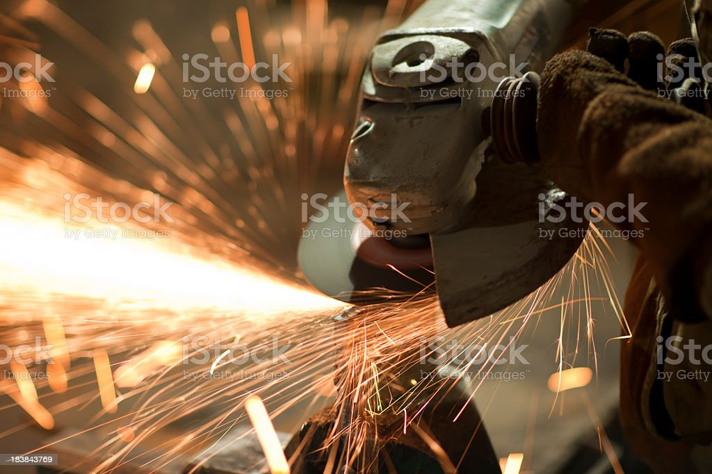 A welder welding with many sparks royalty-free stock photo