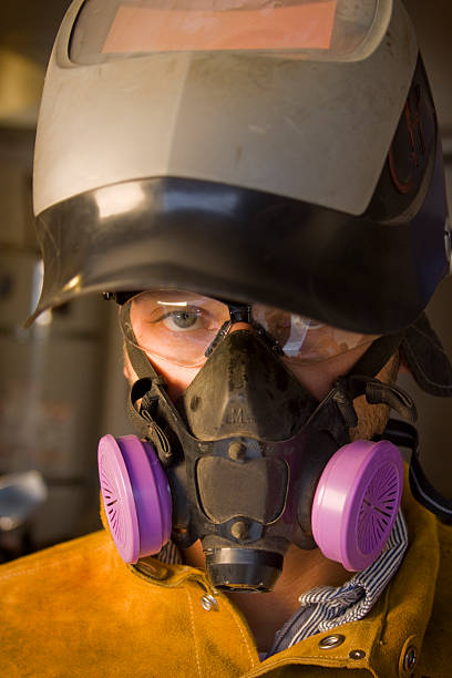 Welder with gas mask