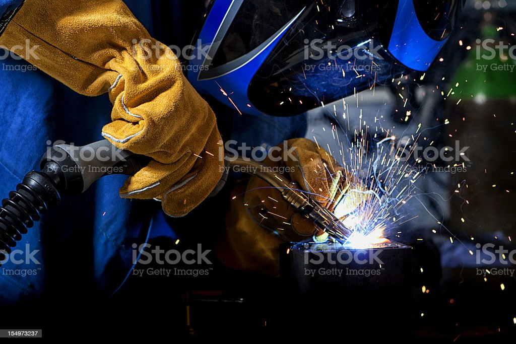 Welder with welding sparks stock photo