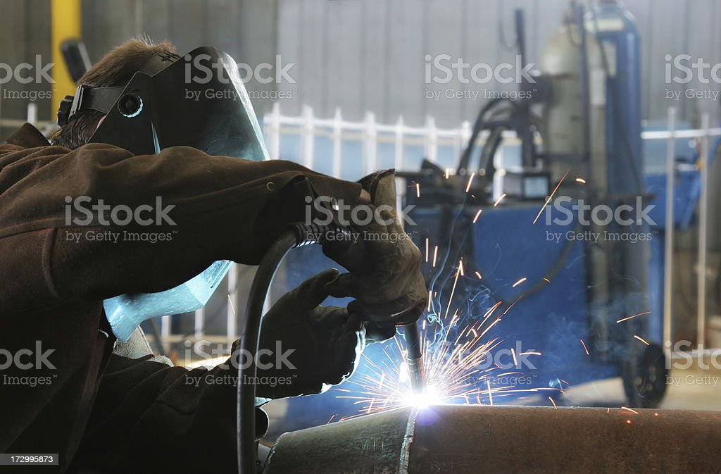 Welder Work inside an Industrial Building stock photo