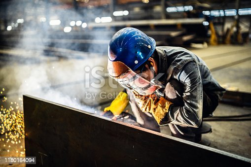 Welder working in a factory.