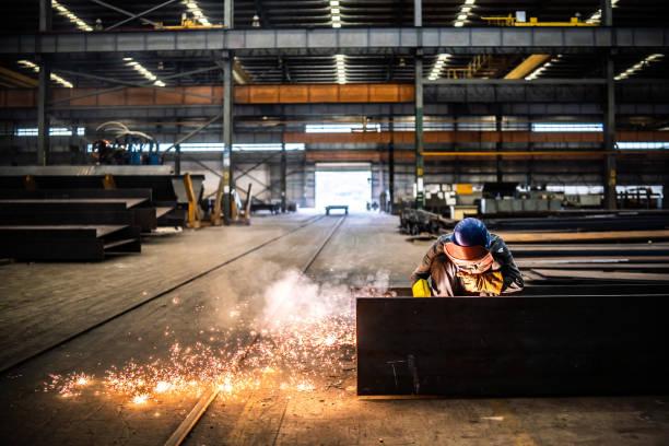 Welder working in a factory stock photo
