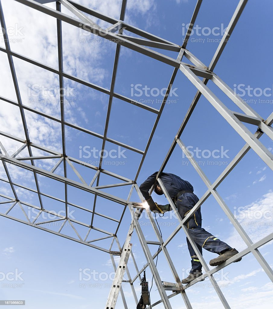 Welder working on the construction stock photo