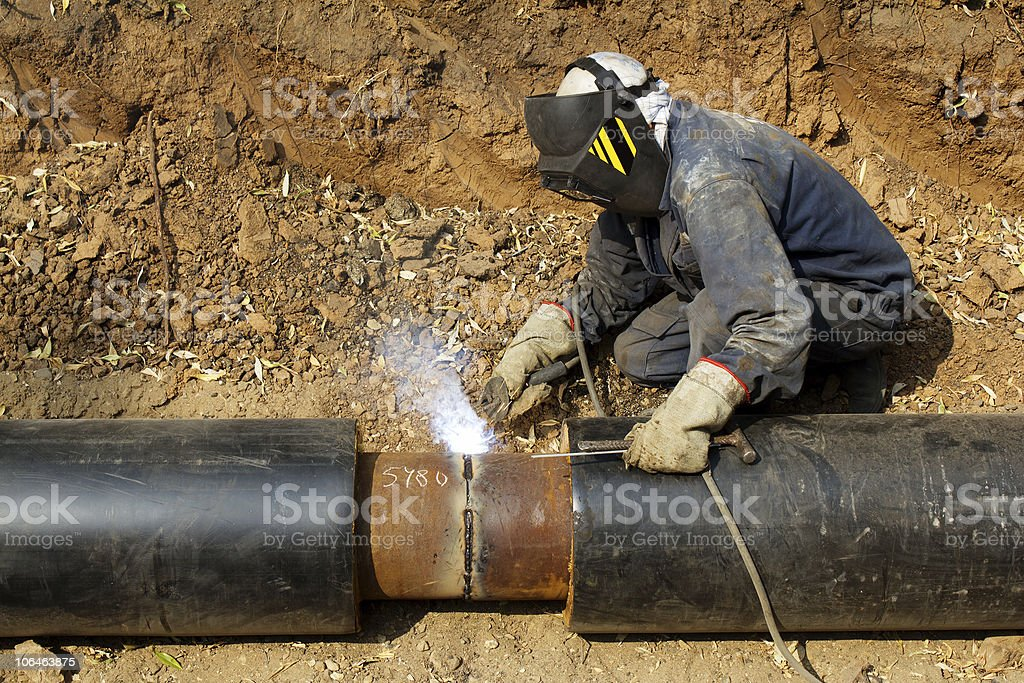Welder working   pipeline royalty-free stock photo