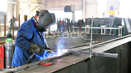 welder works in metal construction