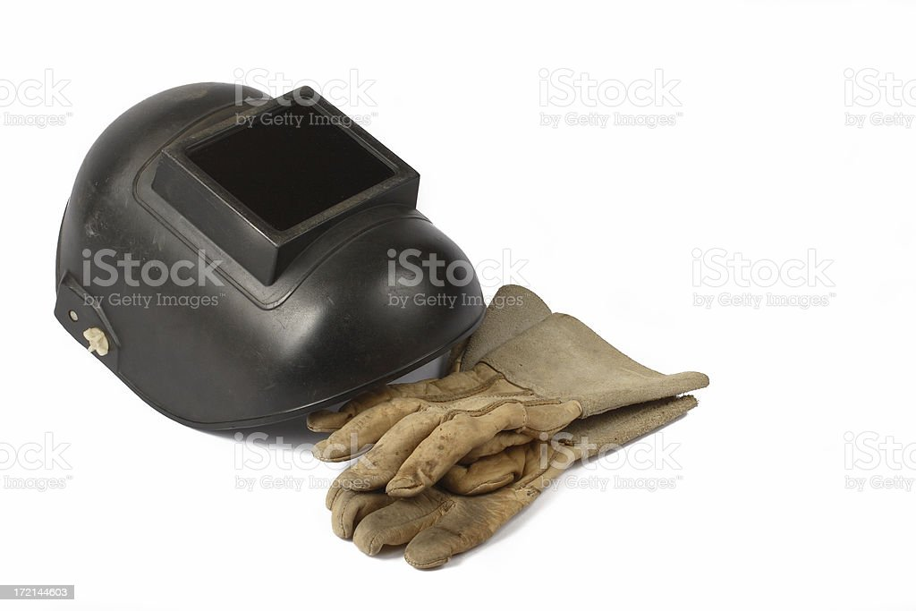 Welder's mask and gloves stock photo