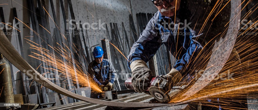 Welders working in workshop stock photo