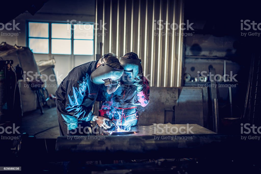 Welders working together stock photo